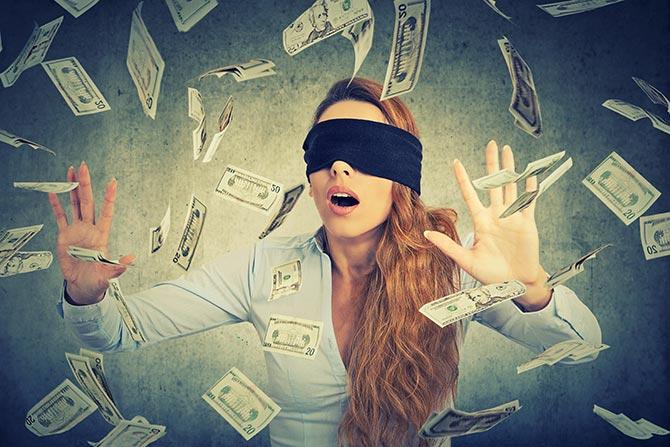 Blind folded lady chasing money