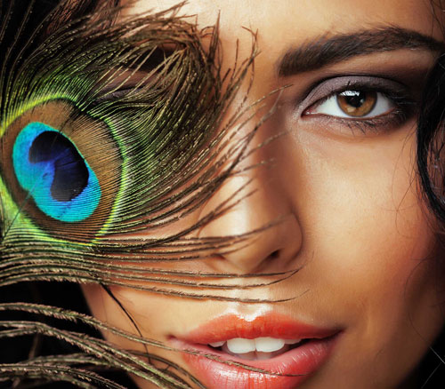 Pretty lady with peacock feather